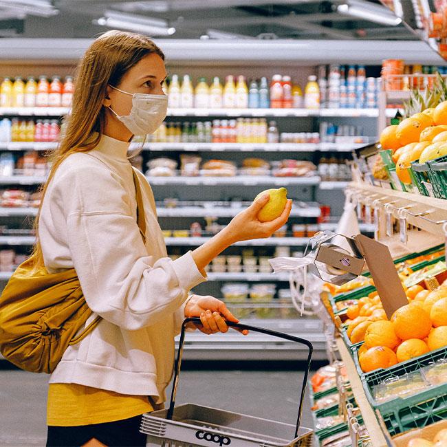 woman shopping wearing a mask