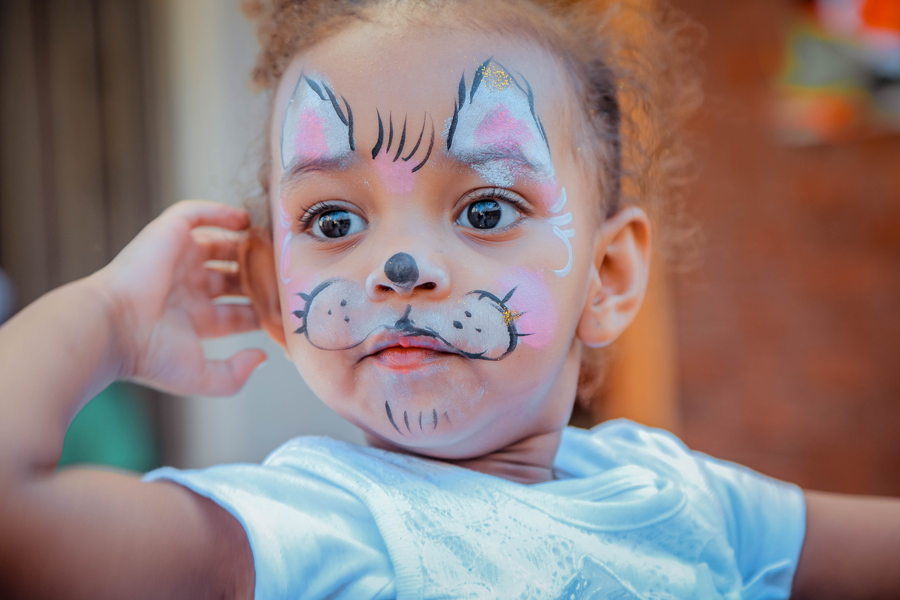 a girl with face paint on